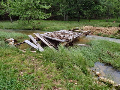 cleaning up the creek bridge will take weeks